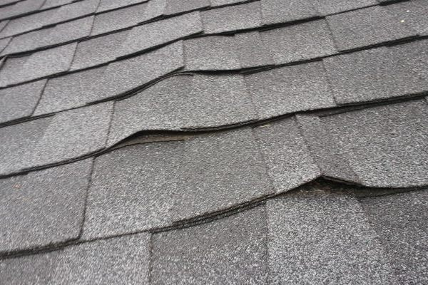 lifting shingle wind roof daamage