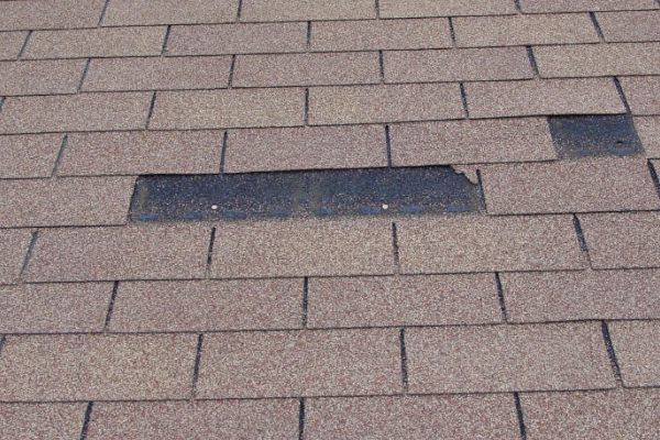 missing shingle roof damage